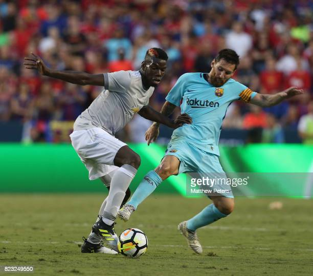 Paul Pogba of Manchester United in action with Lionel Messi of Barcelona during the International Champions Cup 2017 preseason friendly match between...