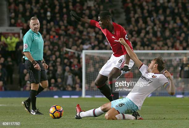 Paul Pogba of Manchester United in action with Mark Noble of West Ham United during the Premier League match between Manchester United and West Ham...