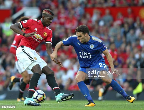 Paul Pogba of Manchester United in action with Matty James of Leicester City during the Premier League match between Manchester United and Leicester...