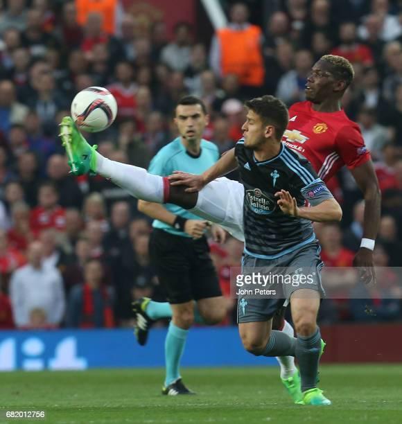 Paul Pogba of Manchester United in action with Nemanja Radoja of Celta Vigo during the UEFA Europa League semi final second leg match between...