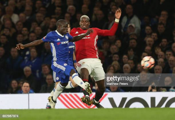 Paul Pogba of Manchester United in action with Ngolo Kante of Chelsea during the Emirates FA Cup QuarterFinal match between Chelsea and Manchester...