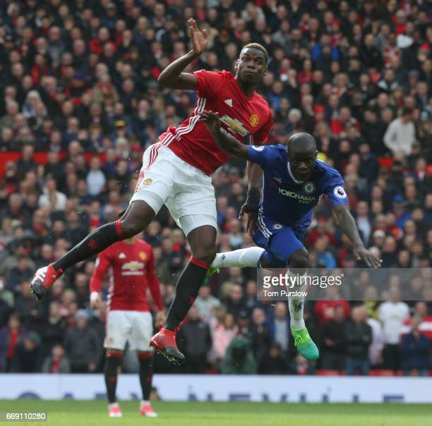 Paul Pogba of Manchester United in action with Ngolo Kante of Chelsea during the Premier League match between Manchester United and Chelsea at Old...