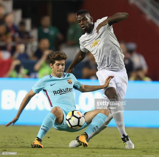 Paul Pogba of Manchester United in action with Sergi Roberto of Barcelona during the International Champions Cup 2017 preseason friendly match...