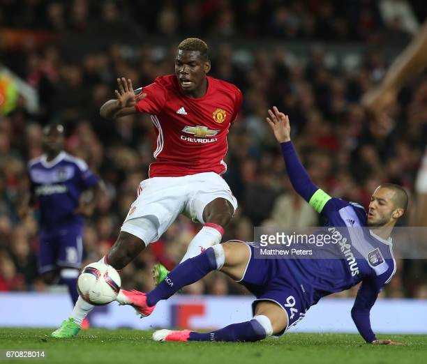 Paul Pogba of Manchester United in action with Sofiane Hanni of RSC Anderlecht during the UEFA Europa League quarter final second leg match between...