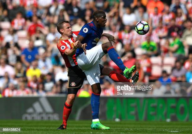 Paul Pogba of Manchester United is challenged by Lee Cattermole of Sunderland during the Premier League match between Sunderland and Manchester...