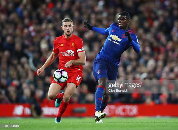 Paul Pogba of Manchester United is closed down by Jordan Henderson of Liverpool during the Premier League match between Liverpool and Manchester...