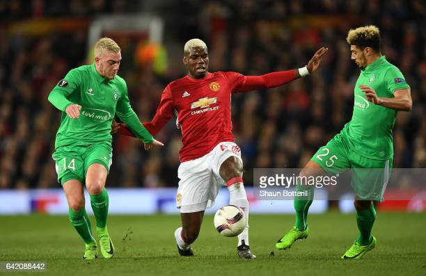 Paul Pogba of Manchester United is closed down by Jordan Veretout of SaintEtienne and Kevin Malcuit of SaintEtienne during the UEFA Europa League...