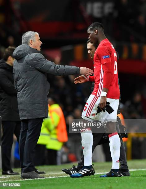 Paul Pogba of Manchester United is consoled by Jose Mourinho Manager of Manchester United as he leaves the pitch due to injury during the UEFA Europa...