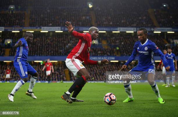 Paul Pogba of Manchester United is marked by Ngolo Kante and Willian of Chelsea during The Emirates FA Cup QuarterFinal match between Chelsea and...