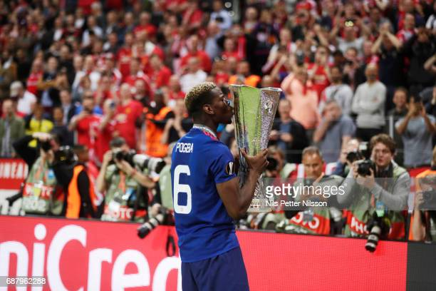 Paul Pogba of Manchester United kisses the trophy during the UEFA Europa League Final between Ajax and Manchester United at Friends Arena on May 24...