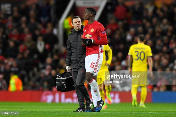 Paul Pogba of Manchester United leaves the pitch due to injury during the UEFA Europa League Round of 16 second leg match between Manchester United...