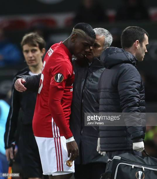 Paul Pogba of Manchester United leaves the pitch with a hamstrong injury during the UEFA Europa League Round of 16 second leg match between...
