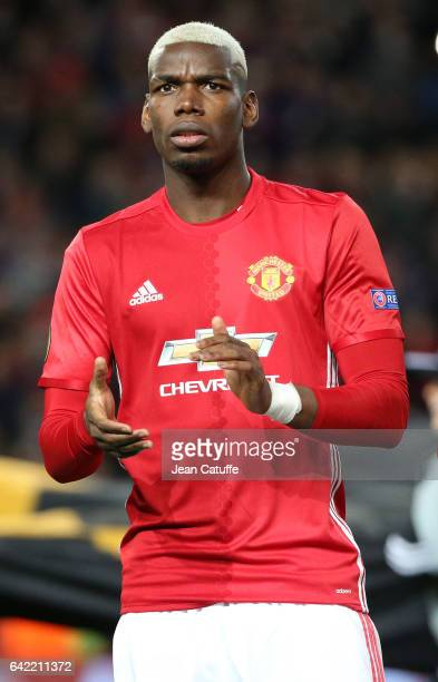 Paul Pogba of Manchester United looks on before the UEFA Europa League Round of 32 first leg match between Manchester United and AS SaintEtienne at...