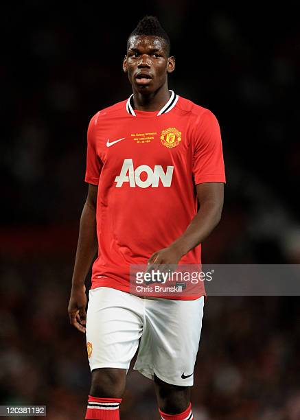 Paul Pogba of Manchester United looks on during Paul Scholes' Testimonial Match between Manchester United and New York Cosmos at Old Trafford on...