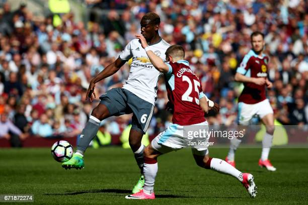 Paul Pogba of Manchester United passes the ball under pressure from Johann Gudmundsson of Burnley during the Premier League match between Burnley and...