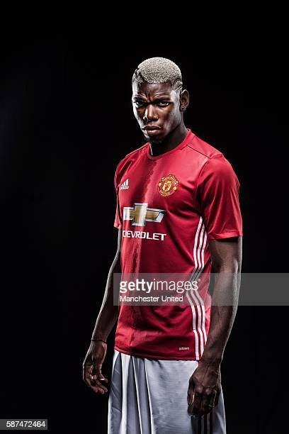 Paul Pogba of Manchester United poses after signing for the club at Aon Training Complex on August 8 2016 in Manchester England