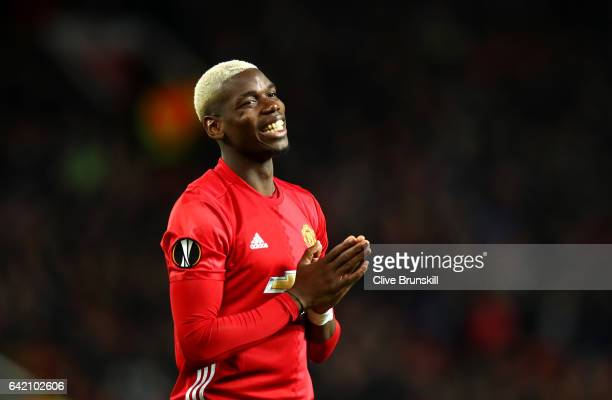 Paul Pogba of Manchester United reacts during the UEFA Europa League Round of 32 first leg match between Manchester United and AS SaintEtienne at Old...