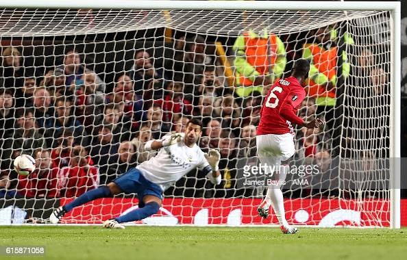 Paul Pogba of Manchester United scores the first goal from a penalty to make the score 10 during the UEFA Europa League match between Manchester...