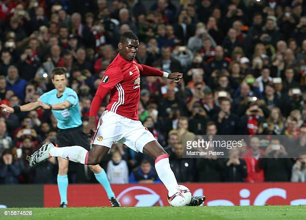 Paul Pogba of Manchester United scores their first goal during the UEFA Europa League match between Manchester United FC and Fenerbahce SK at Old...