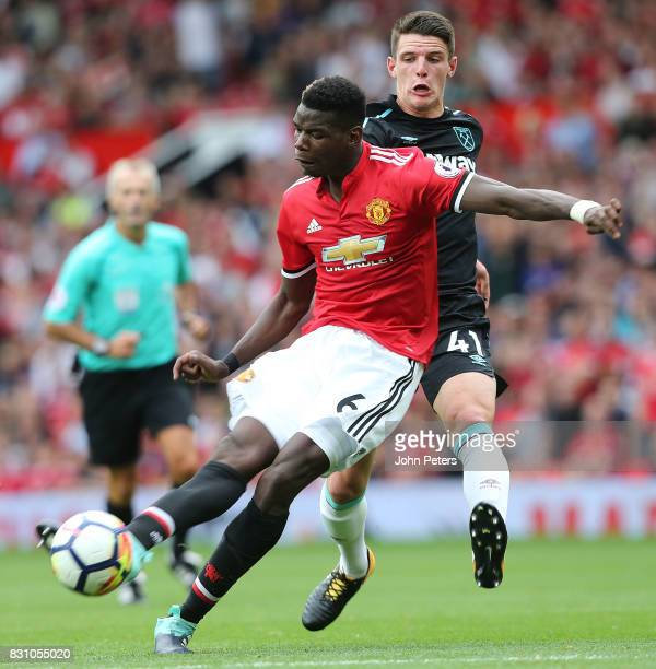 Paul Pogba of Manchester United scores their fourth goal during the Premier League match between Manchester United and West Ham United at Old...