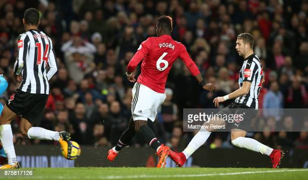 Paul Pogba of Manchester United scores their third goal during the Premier League match between Manchester United and Newcastle United at Old...
