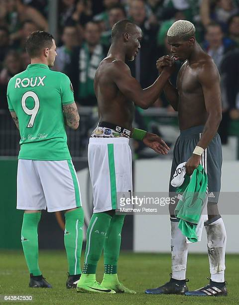 Paul Pogba of Manchester United shakes hands with his brother Florentin Pogba of AS SaintEtienne after the UEFA Europa League Round of 32 second leg...