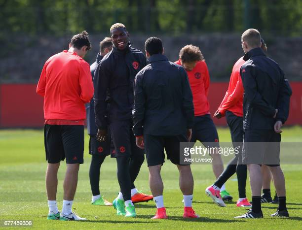 Paul Pogba of Manchester United shares a joke with team mates during a training session at the Aon Training Complex on May 3 2017 in Manchester...