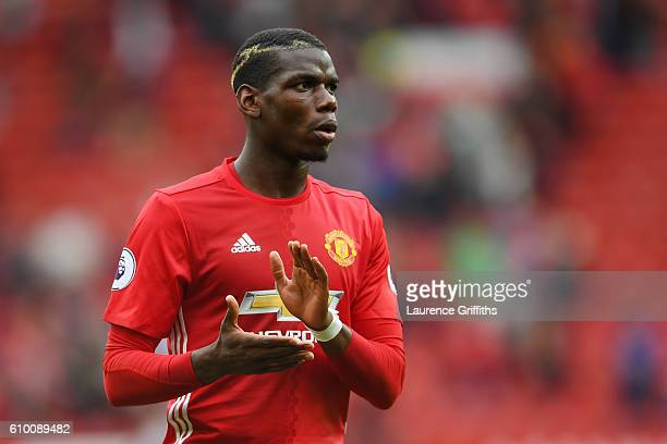Paul Pogba of Manchester United shows his appreciation for the fans after the final whistleduring the Premier League match between Manchester United...
