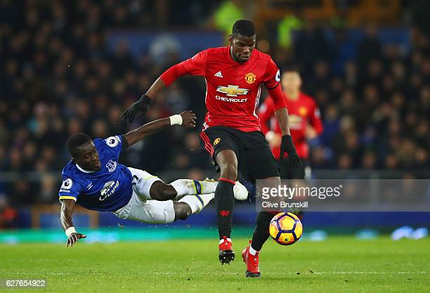 Paul Pogba of Manchester United shrugs off Idrissa Gueye of Everton during the Premier League match between Everton and Manchester United at Goodison...