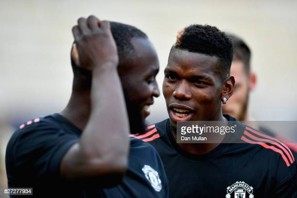 Paul Pogba of Manchester United speaks to Romelu Lukaku of Manchester United during a training session ahead of the UEFA Super Cup final between Real...