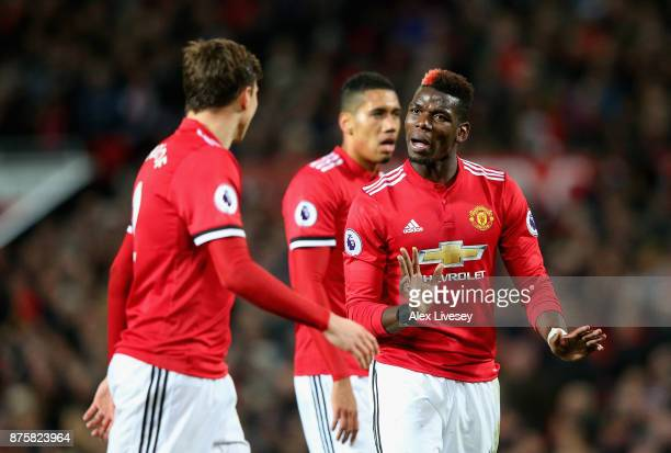 Paul Pogba of Manchester United speaks with Victor Lindelof of Manchester United during the Premier League match between Manchester United and...