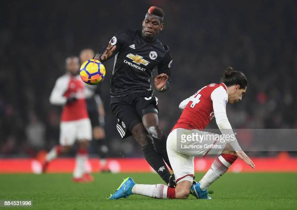 Paul Pogba of Manchester United stamps on Hector Bellerin of Arsenal and is later sent off for the challenge during the Premier League match between...