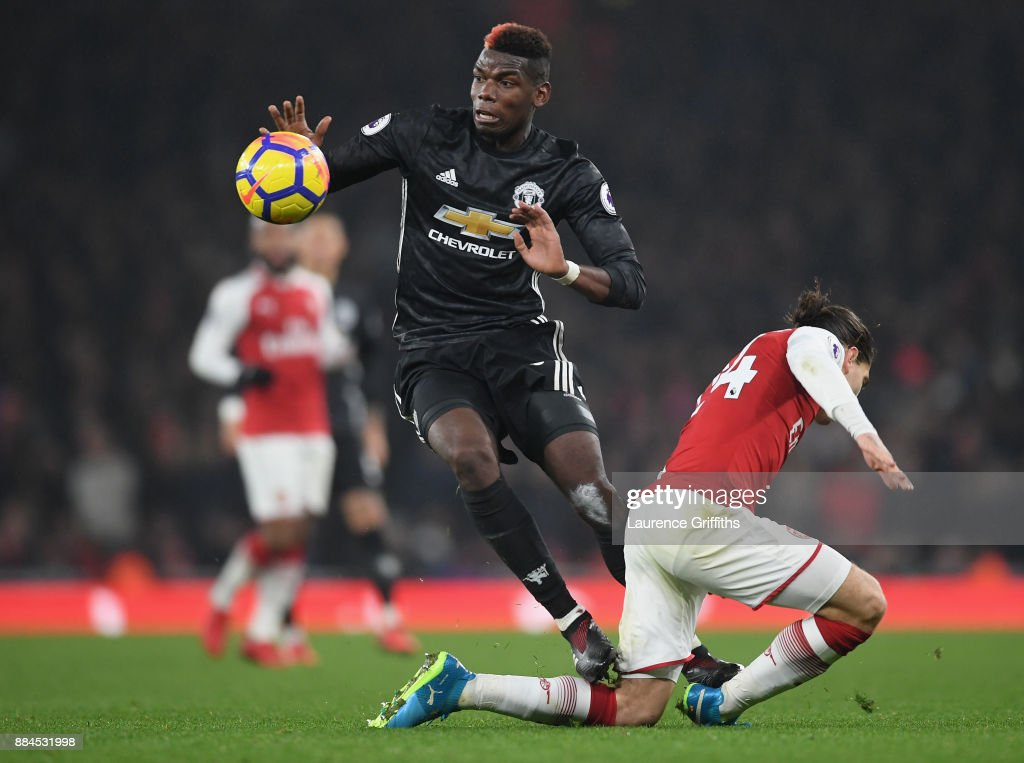Paul Pogba of Manchester United stamps on Hector Bellerin of Arsenal and is later sent off for the challenge during the Premier League match between Arsenal and Manchester United at Emirates Stadium on December 2, 2017 in London, England.