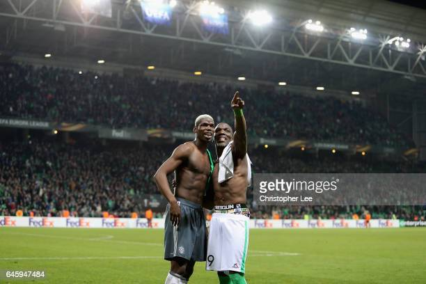 Paul Pogba of Manchester United swaps shirts and jokes with his brother Florentin Pogba of SaintEtienne during the UEFA Europa League Round of 32...