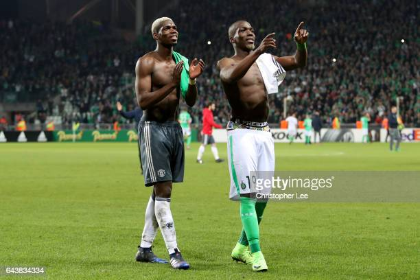 Paul Pogba of Manchester United swaps shirts with his brother Florentin Pogba of SaintEtienne after the UEFA Europa League Round of 32 second leg...