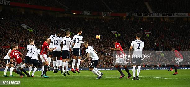 Paul Pogba of Manchester United takes a free kick hitting a post during the Premier League match between Manchester United and Tottenham Hotspur at...