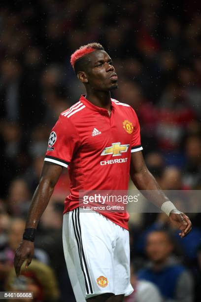 Paul Pogba of Manchester United walks off injured during the UEFA Champions League group A match between Manchester United and FC Basel at Old...