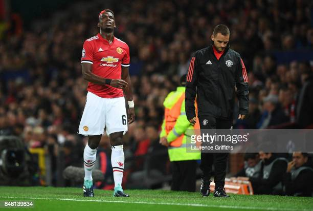 Paul Pogba of ManchesterUnited reacts to being forced off through injury during the UEFA Champions League Group A match between Manchester United and...