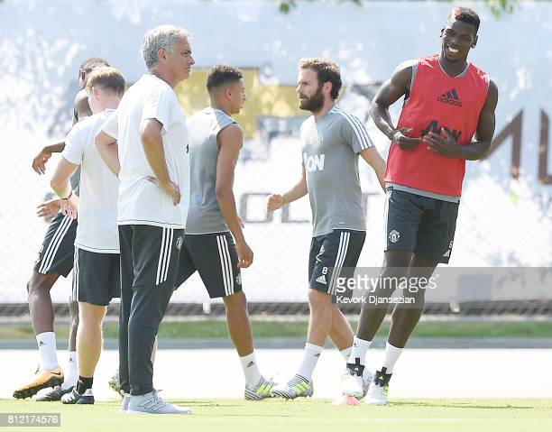 Paul Pogba of the Manchester United runs with manager Jose Mourinho looking on during a training session for Tour 2017 at UCLA's Drake Stadium July...