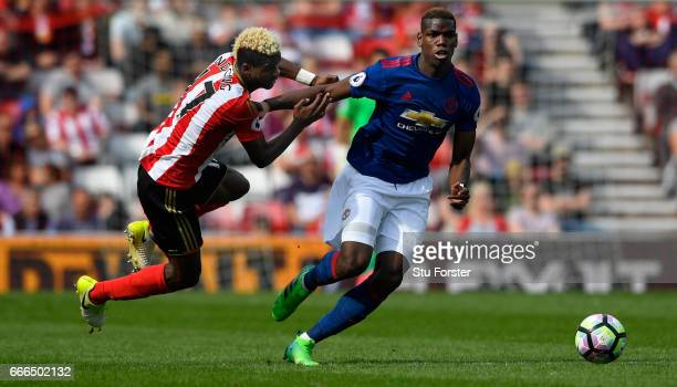 Paul Pogba of United brushes off the challenge of Didier Ndong of Sunderland during the Premier League match between Sunderland and Manchester United...