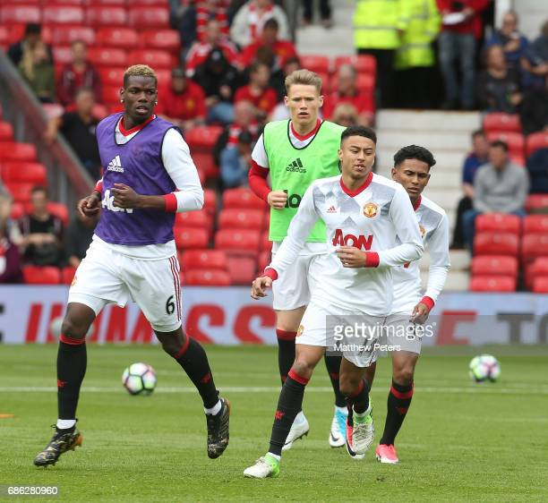 Paul Pogba Scott McTominay Jesse Lingard and Demitri Mitchell of Manchester United warm up ahead of the Premier League match between Manchester...