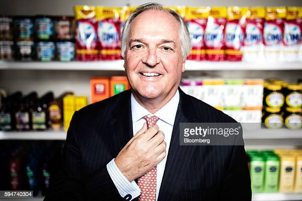 Paul Polman chief executive officer of Unilever NV poses for a photograph with a selection of Unilever products at their headquarters in London UK on...