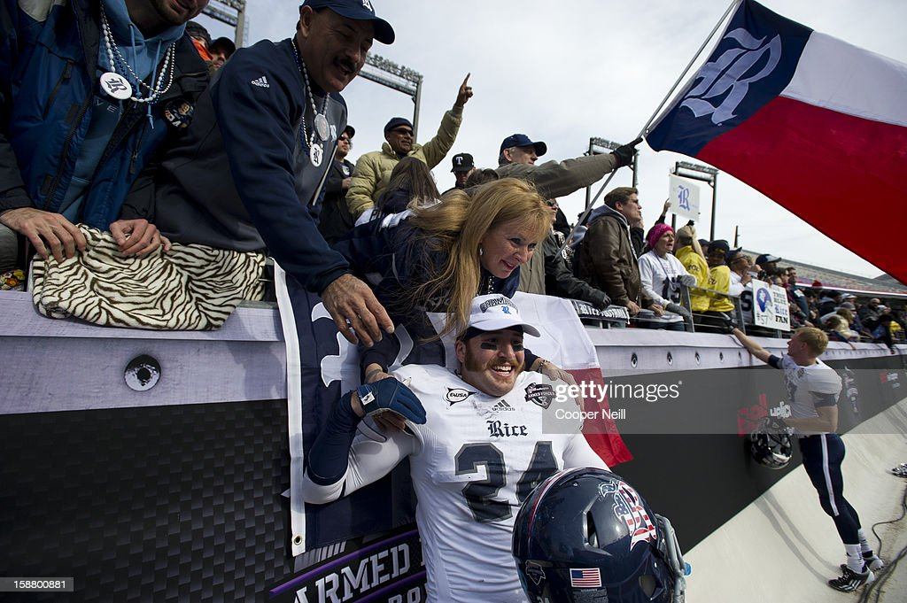 Paul Porras #24 of the Rice Owls poses for a photo with fans after defeating the Air Force Falcons on December 29, 2012 in the Bell Helicopter Armed Forces Bowl at Amon G. Carter Stadium in Fort Worth, Texas.