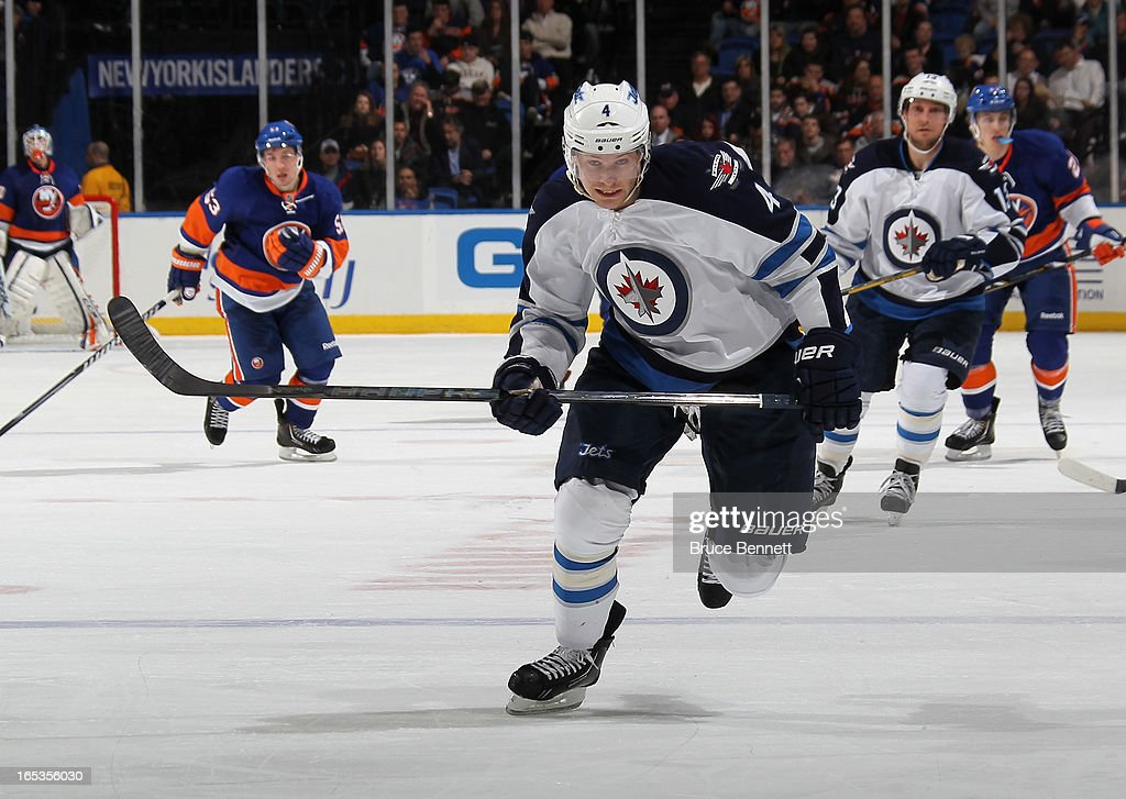 Paul Postma #4 of the Winnipeg Jets skates against the New York Islanders at the Nassau Veterans Memorial Coliseum on April 2, 2013 in Uniondale, New York. The Islanders defeated the Jets 5-2.