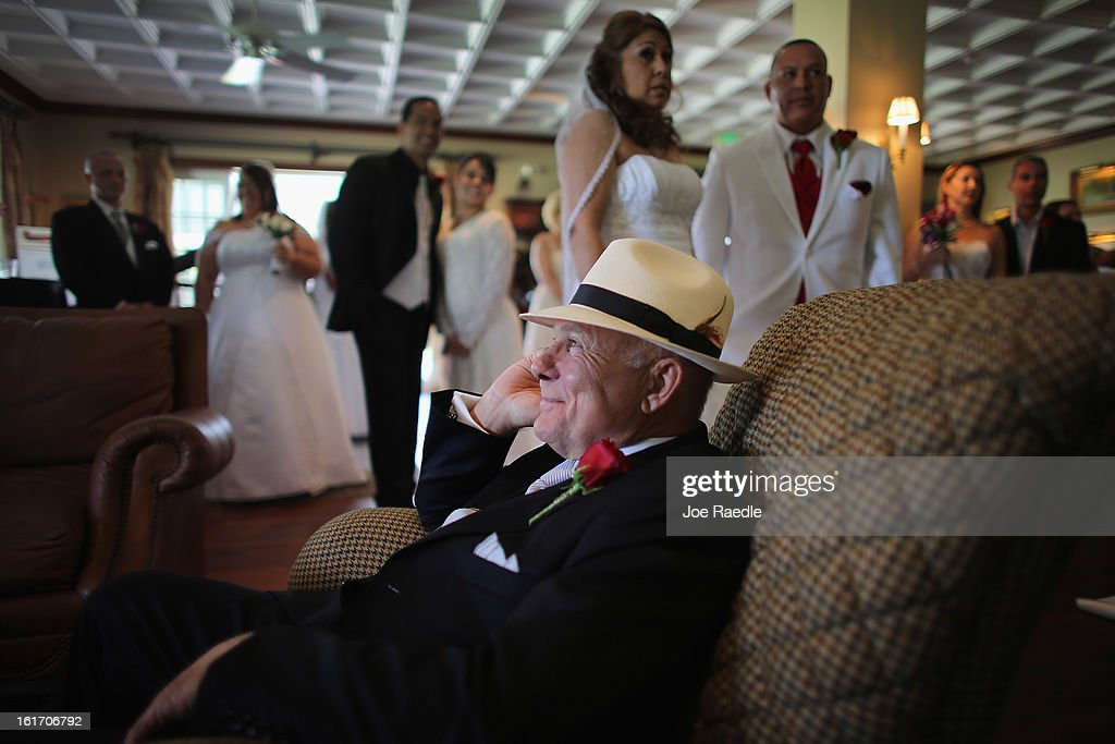 Paul Preston sits in a chair as he waits to be wed during a group Valentine's day wedding at the National Croquet Center on February 14, 2013 in West Palm Beach, Florida. The group wedding ceremony is put on by the Palm Beach Country Clerk & Comptroller's office and approximately 40 couples tied the knot.