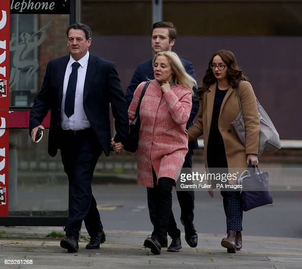 Paul Price the stepfather of model Katie Price is accompanied by her mother Amy Price as he arrives at Chichester Crown Court where he will stand...