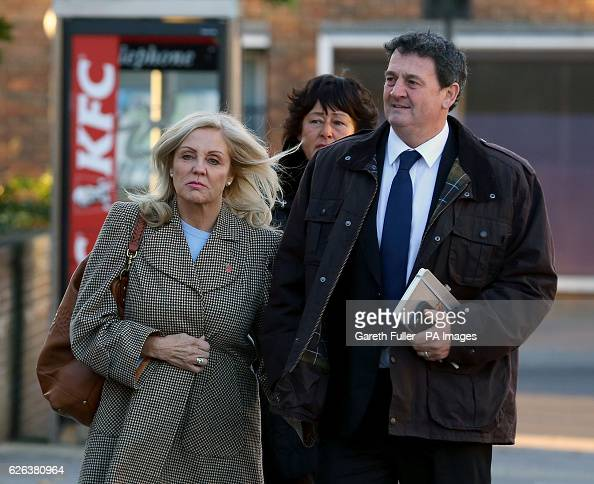 Paul Price the stepfather of model Katie Price is accompanied by his wife Amy Price as he arrives at Chichester Crown Court where he is standing...