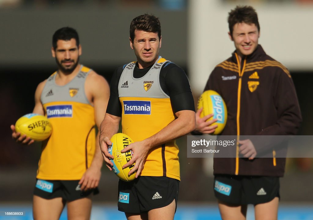 Paul Puopolo, Jonathan Simpkin and Liam Shiels of the Hawks look on during a Hawthorn Hawks AFL training session at Waverley Park on May 13, 2013 in Melbourne, Australia.