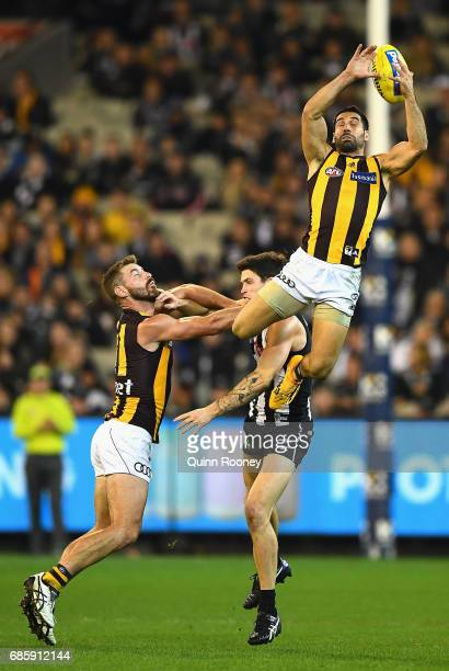 Paul Puopolo of the Hawks attempts to mark over the top of Jack Crisp of the Magpies during the round nine AFL match between the Collingwood Magpies...