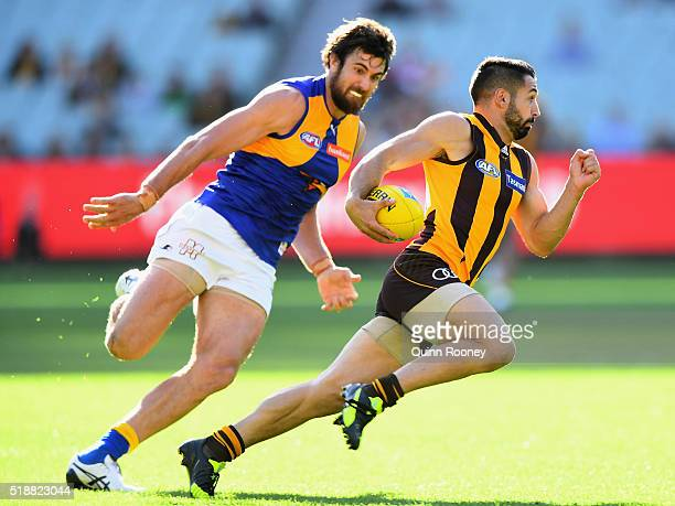Paul Puopolo of the Hawks is chased by Josh Kennedy of the Eagles during the round two AFL match between the Hawthorn Hawks and the West Coast Eagles...
